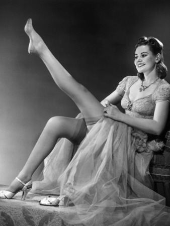 george-marks-woman-in-evening-wear-pullin-on-silk-stockings